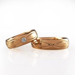 Raudono aukso vestuviniai žiedai su begalybės ženklu
